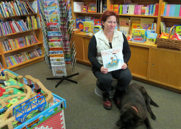 Curious Cup bookstore owner Kiona Gross will celebrate two years at the shop's 929 Linden Ave. location in Carpinteria in January. Gross, who runs the store with the help of her dog, Molly, said the children's section was originally intended to be a café. (Gina Potthoff / Noozhawk photo)