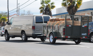 After a raid on an East Haley Street building in May, Drug Enforcement Administration agents packed a van and trailer with material confiscated from the property. (Lara Cooper / Noozhawk file photo)