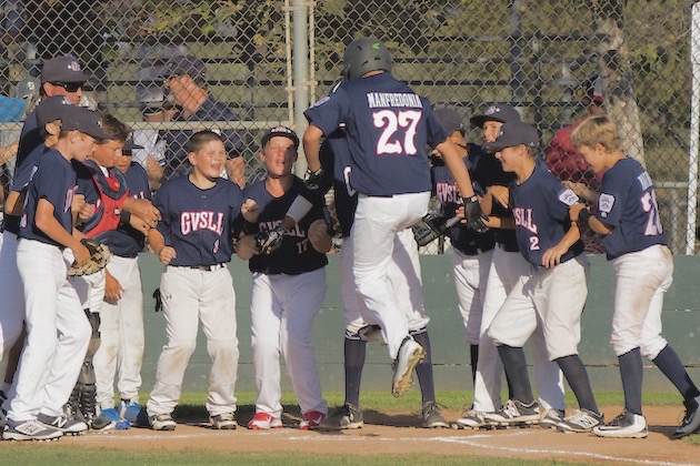 Henry Manfredonia is congratulated by his Goleta Valley South teammates after reaching home plate during Wednesday's 3-2 victory over Dos Pueblos.