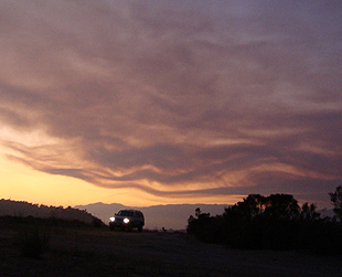 Smoke waves from the La Brea Fire gave the sky an artistic pattern Friday night in a photo taken from Elings Park.