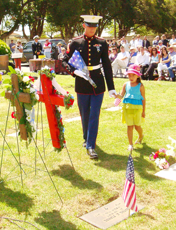 Cpl. Justin Simandle and friend make a Memorial Day presentation at the Carpinteria Cemetery.