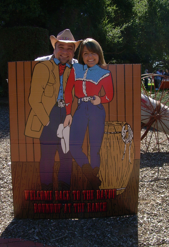 Rescue Mission volunteer Mark Diggs and staffer Lizzy MacRae get into the spirit of the Western-themed event!