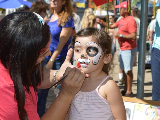 <p>Isabella Salazar, 2, gets her face painted during the California Avocado Festival in Carpinteria on Saturday.</p>
