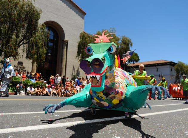 A dragon float is pushed up State Street during the parade.