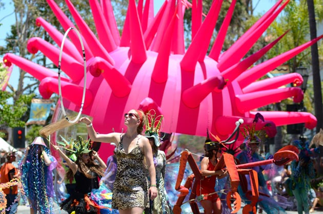A large, inflatable float accompanied performers as the parade rolled up State Street toward Alameda Park.