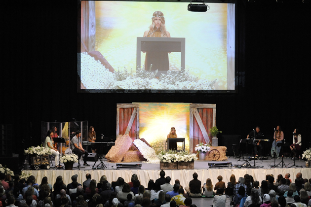 Kate Merrick, Daisy Love's mom, shares a passage from 'The Chronicles of Narnia' at her daughter's memorial service Saturday at SBCC's Sports Pavilion. 'She is going further up! And further in!' she exclaimed.