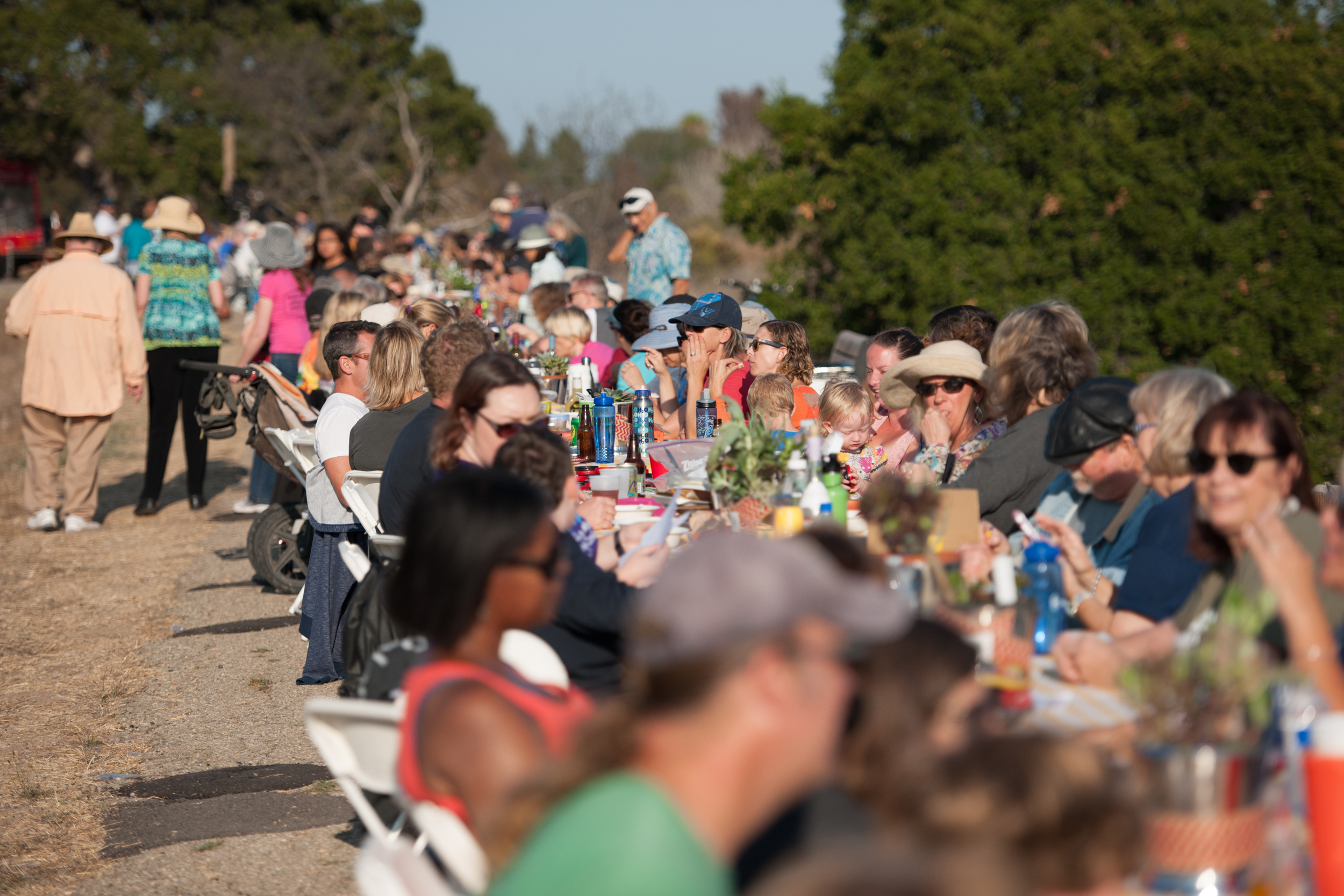 About 300 people have dinner on the Lake Los Carneros Dam for the fourth annual Goleta event.