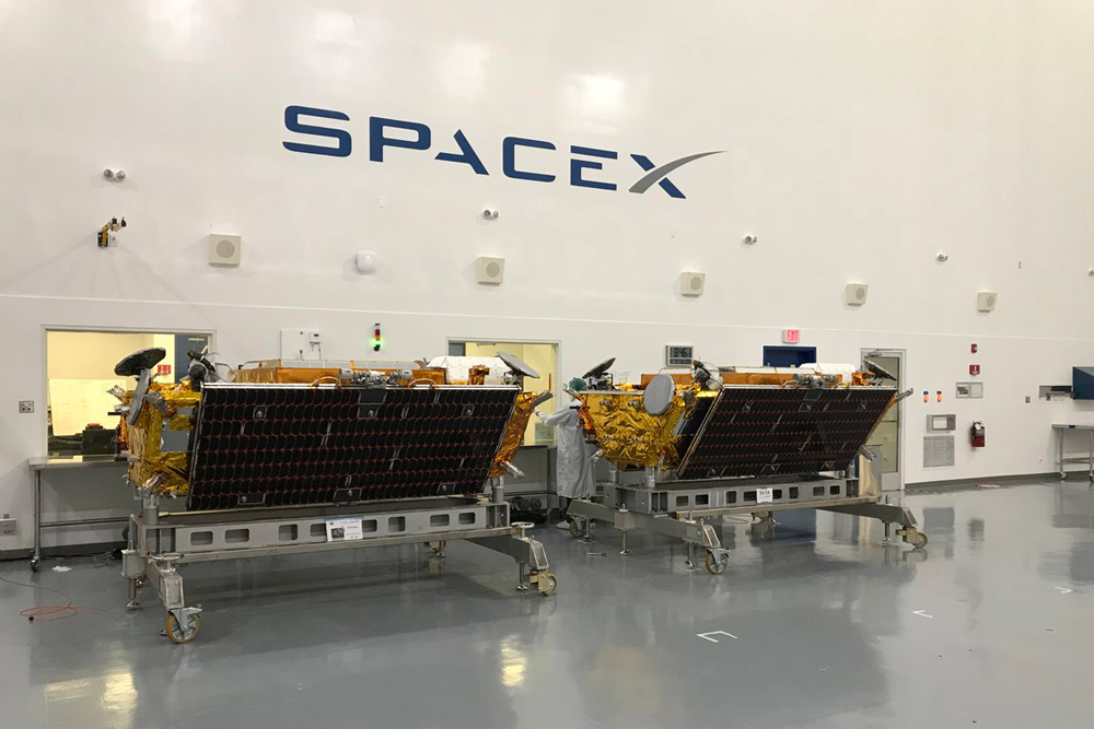 Iridium Next satellites sit in a SpaceX facility awaiting final placement on the Falcon 9 rocket at Vandenberg Air Force Base.