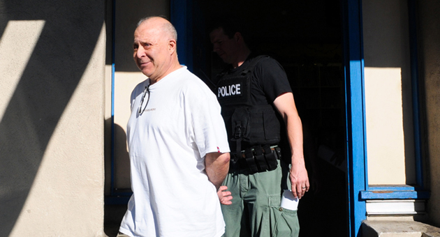 Dr. Julio Diaz was escorted from his medical office on Milpas Street in Santa Barbara in early January by a federal agent after being arrested for allegedly overprescribing prescription medications. He was released from jail last week on bail. (Lara Cooper / Noozhawk file photo)