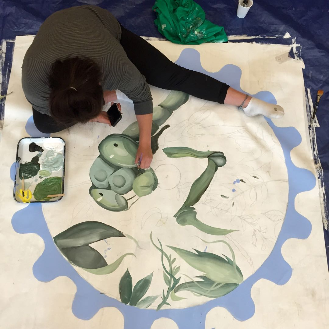 A teen works on a panel for the Arts Fund mural being added to the Santa Maria Valley Discovery Museum wall.