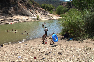 Swimmers cool off in the summer heat at a pool on the Santa Ynez River, where earlier in the day an 8-year-old boy drowned. (Victoria Sanchez photo / KEYT.com)