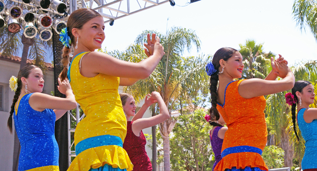 Flamenco dancers from the Garcia Dance Studio entertain the crowd at El Mercado De la Guerra on the opening day of Santa Barbara's Old Spanish Days Fiesta. (Tom Bolton / Noozhawk photo)