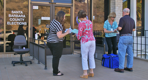 Santa Barbara County elections workers were on hand Monday to greet a steady stream of voters dropping off mail-in ballots at the Elections Office in Santa Barbara, ahead of Tuesday's general election. Polls open at 7 a.m. Tuesday and close at 8 p.m. (Tom Bolton / Noozhawk photo)