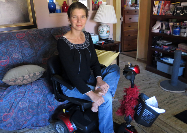 Since a diving accident in Indonesia took a toll on Emese Dunai's health and state of mind, she's been confined to her Santa Maria home and a motorized scooter. Now she's on a quest for a service dog to help her cope. 'You have to get up,' Dunai says. 'You have to take them for a walk. More important for me is having a best friend. It would be great to have a dog at my side. I get so tired so easily.' (Gina Potthoff / Noozhawk photo)