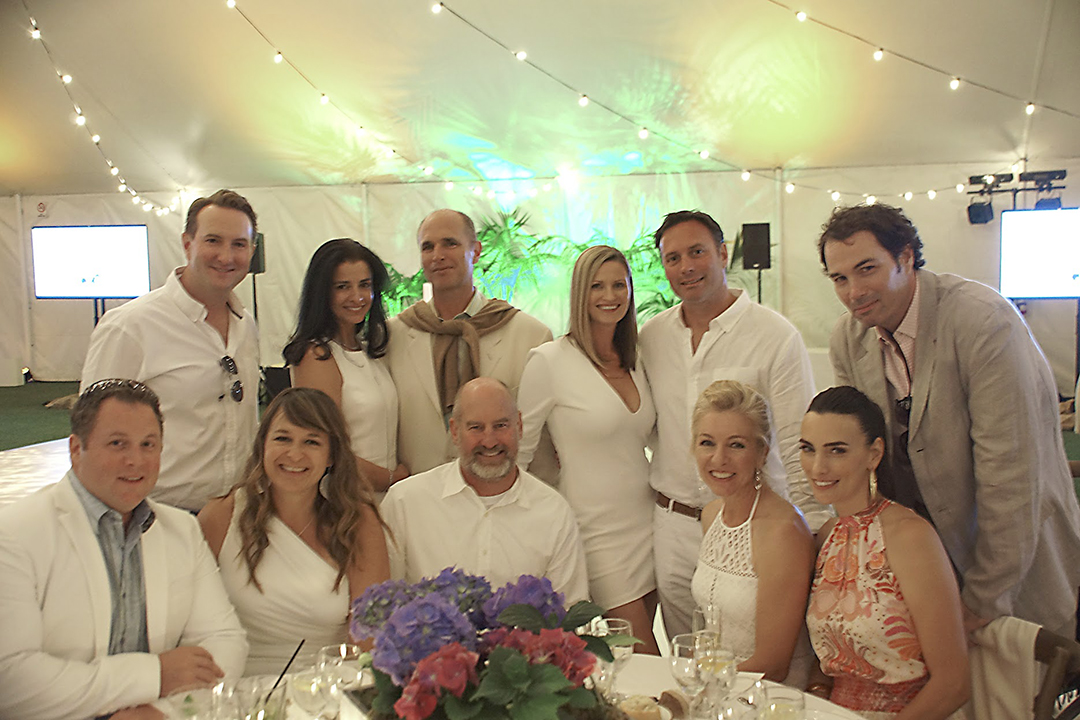 Marymount supporters dressed all in white gather at An Evening in White at the Hamptons. (Back row) Montauk Sponsor Josh Connor, Sag Harbor Sponsor Helen and John Michael Lind, Crystal and Greg Jensen, and Montauk Sponsor John Keister. (Front row) Kristopher Park and Marymount art teacher Jill-Ashley Park, Neil and Tina Wood, and Montauk Sponsor Cassie Keister.