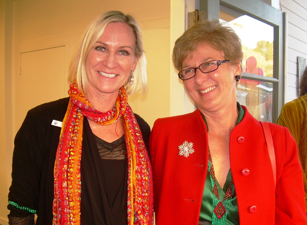 Friendship Center Executive Director Heidi Holly, left, and Carrie Topliffe of Oak Unitarian Universalist Congregation celebrate the Friendship Center's new center at the Goleta church during Thursday's Open House and Family Caregiver Holiday Party.