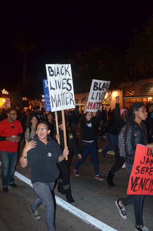 Protesters Make Their Way Down State Street In Santa