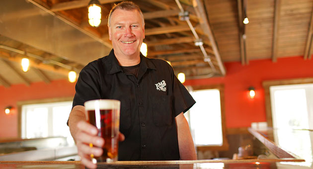 <p>Taproom manager David Esdaile toasts with a beer in the new Figueroa Mountain Brewing Company tasting location in Los Olivos, the third taproom the company has opened in its three years.</p>