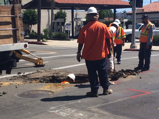 Municipal crews repair the sinkhole at the intersection of Mission and State streets Saturday afternoon. (Colin Fraser Purcell photo)