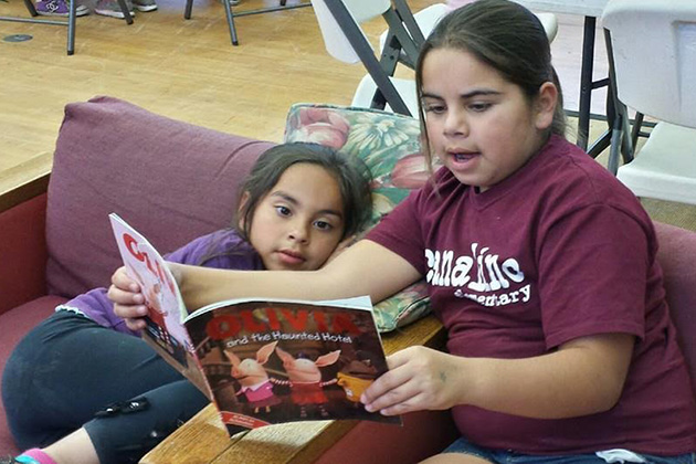 Girls Inc. of Carpinteria's new literacy program focuses on utilizing books featuring strong female characters as the catalyst for learning. Pictured here, Girls Inc. members Natalia O. (left) and Vanessa O. (right) participate in a read-aloud of 'Olivia.'
