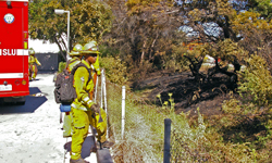 A CalFire crews monitors the mop-up operation for a fire that threatened structures in Goleta Thursday afternoon. (Tom Bolton / Noozhawk photo)