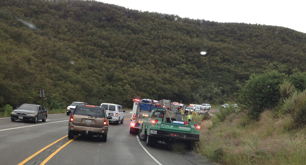 Traffic is backed up on Highway 154 Monday as emergency crews respond to a vehicle that drove off the roadway and plunged 200 feet down the hillside. Two possible injuries were reported. (Dave Bemis photo)