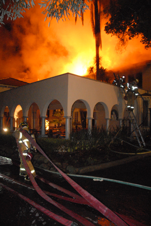 Flames rip through a home in the 400 block of Hot Springs Road in Montecito on Saturday night. (Ryan Cullom photo)