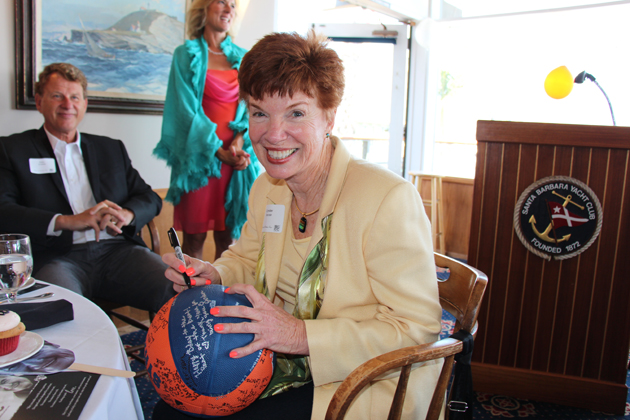 Cynder Sinclair sign a basketball with birthday greetings.