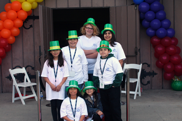 Boys & Girls Club of Santa Barbara members greeted guests for the St. Patrick's Day-themed 'Pot O' Gold' fundraiser at the Armory doors wearing green top hats under a rainbow of balloons.