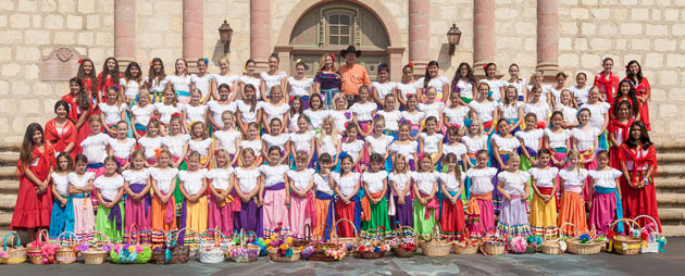The 2013 Old Spanish Days Fiesta Flower Girls pose for their official portrait July 20 on the steps of the Santa Barbara Mission.