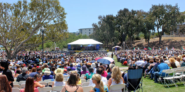 Thousands of family and friends packed the UCSB Faculty Club Green to cheer on the graduates. (Alex Kacik / Noozhawk photo)
