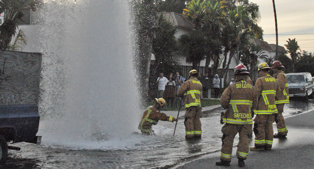 <p>Santa Barbara County firefighters work to shut off water to a fire hydrant that was sheared off by a vehicle in Isla Vista on Wednesday afternoon. No injuries were reported.</p>