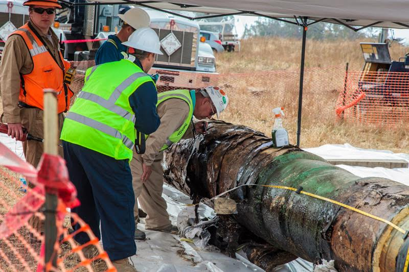 The damaged pipe section was removed from the trench and transported a short distance to a covered area where it was inspected under the continuous and watchful eye of security staff and California Department of Fish and Wildlife personnel.