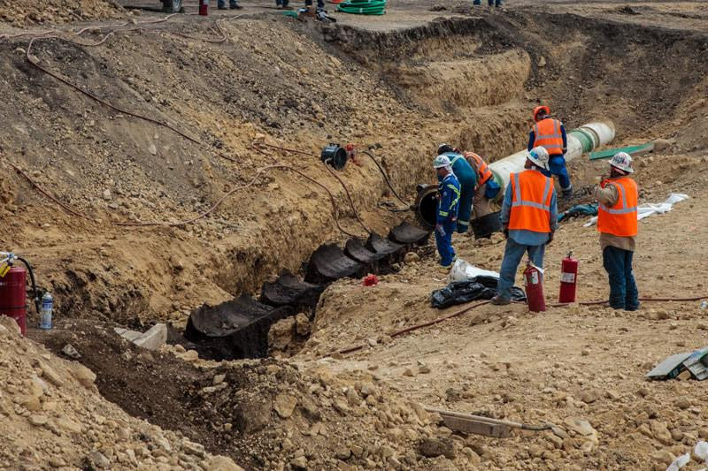A large quantity of contaminated material remained in the bottom of the trench.
