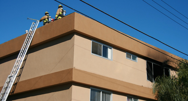 Firefighters mop up after fire broke out Thursday at an Isla Vista apartment. No injuries were reported. (Santa Barbara County Fire Department photo)