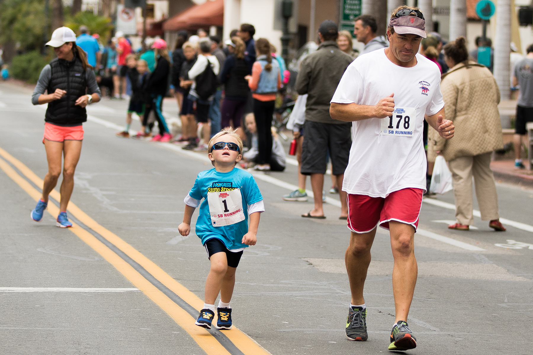 A father and his son participate in the Family Mile on State Street.
