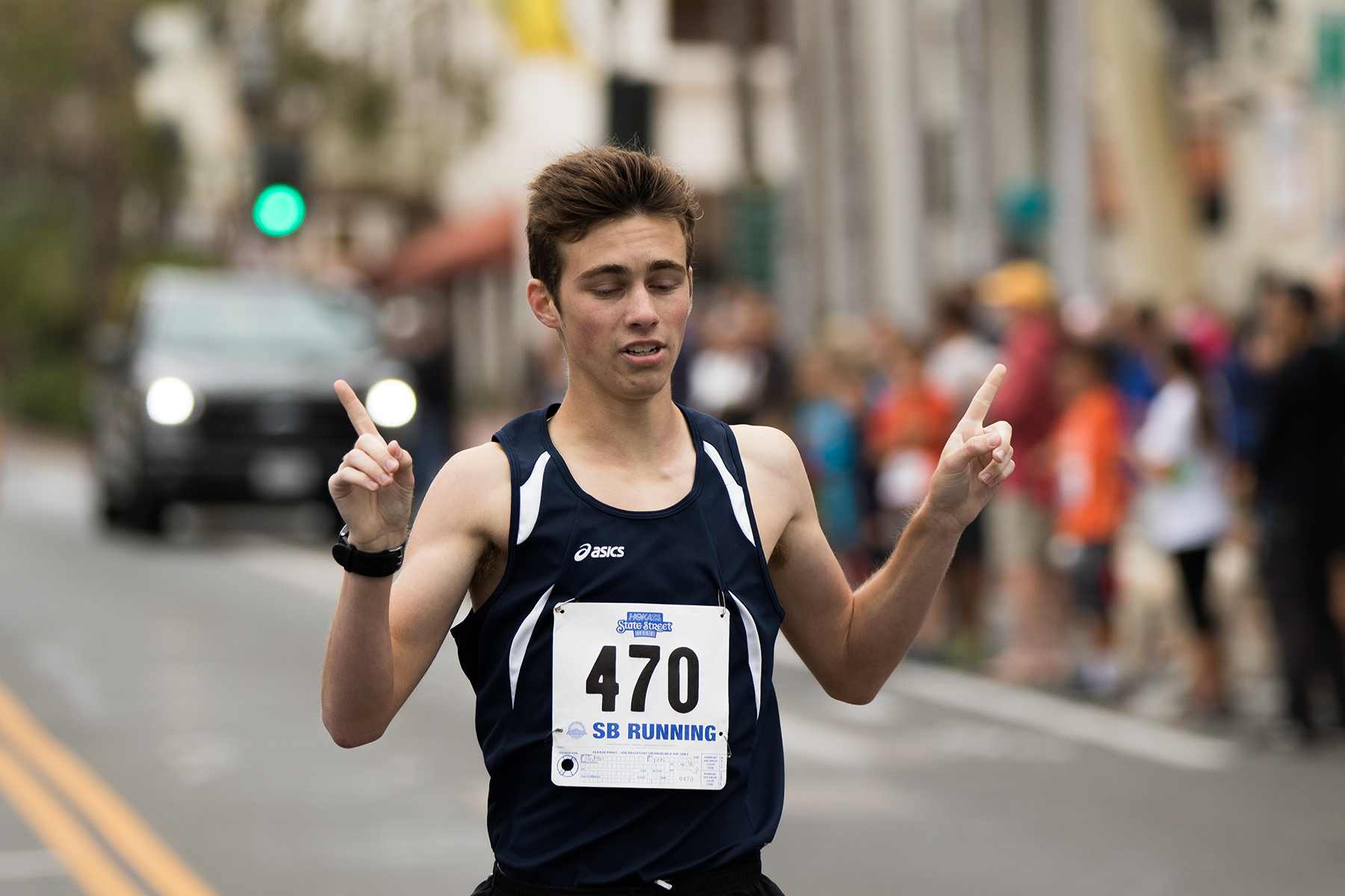 Ryan Painter, 18, of Stevenson Ranch, strikes a pose after winning the boy's 15-19 age group with a time of 4:22.
