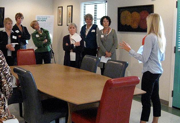 Jen Goebel, right, program director of My Home at Artisan Court, outlines for Women's Fund members the plethora of services provided for youth who have aged out of the foster care system.