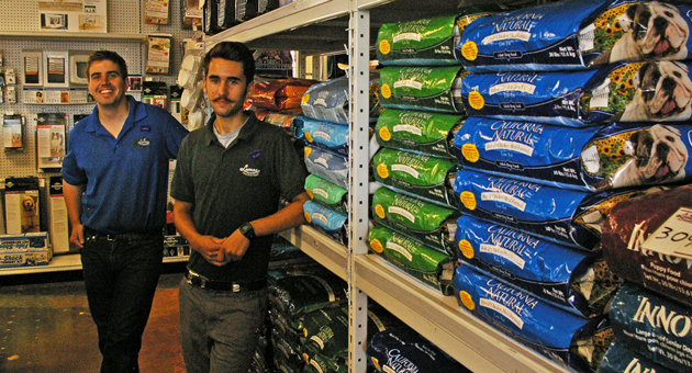 Cameron Vanetti, left, and Geoff Shea serve customers at Lemos Feed & Pet Supply in Goleta, which has moved to a new location at 5880B Calle Real. (Tom Bolton / Noozhawk photo)