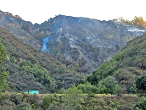 Charred hillsides on Thursday show the burn area from the Lookout Fire near Painted Cave, which threatened homes and prompted evacuations Wednesday. (Suzanne Farwell photo)
