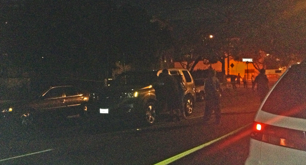 An SUV sits on Salinas Street in Santa Barbara Tuesday night after striking a 3-year-old boy who ran into the roadway, according to police. The toddler, who suffered non-life-threatening injuries, was taken to Santa Barbara Cottage Hospital. (Shirin Rajaee / KEYT News photo)