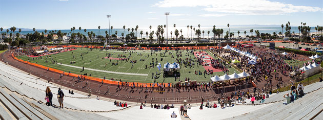 The football field at SBCC's La Playa Stadium is packed with competitors and supporters during the Select Staffing Santa Barbara International Marathon and Half-Marathon. (Garrett Geyer / Noozhawk photo)
