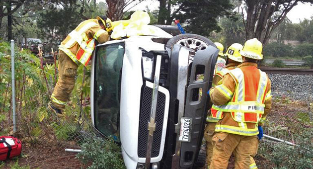 A woman was injured Friday when a pickup truck rolled over on southbound Highway 101 at Milpas Street in Santa Barbara. (Mike de Ponce / Santa Barbara Fire Department photo)