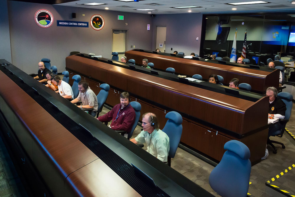 Personnel at the Missile Defense Integration and Operation Center on Schriever Air Force Base in Colorado Springs, Colorado, work at the test control facility during a prior flight test for the Ground-based Midcourse Defense program.