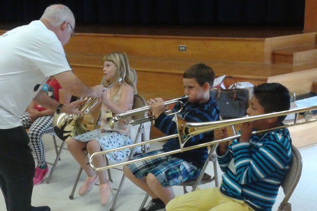 Students from Monroe School in Santa Barbara get an introduction to orchestral instruments thanks to a visit from the Santa Barbara Symphony's award-winning Music Van.