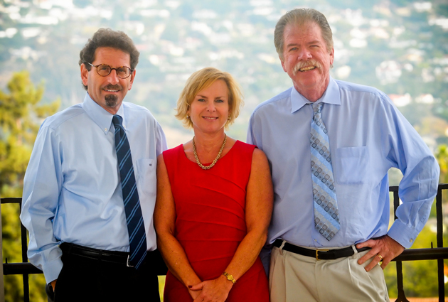 <p>The Noozhawk executive team atop the Santa Barbara County Courthouse: founder and publisher Bill Macfadyen, left; Kim Clark, vice president of business development; and executive editor Tom Bolton.</p>