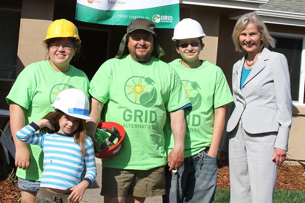 The Gomez family, who built their home as part of the Self-Help Home program, stands with U.S. Congresswoman Lois Capps during the 2015 Solarthon in Los Alamos.