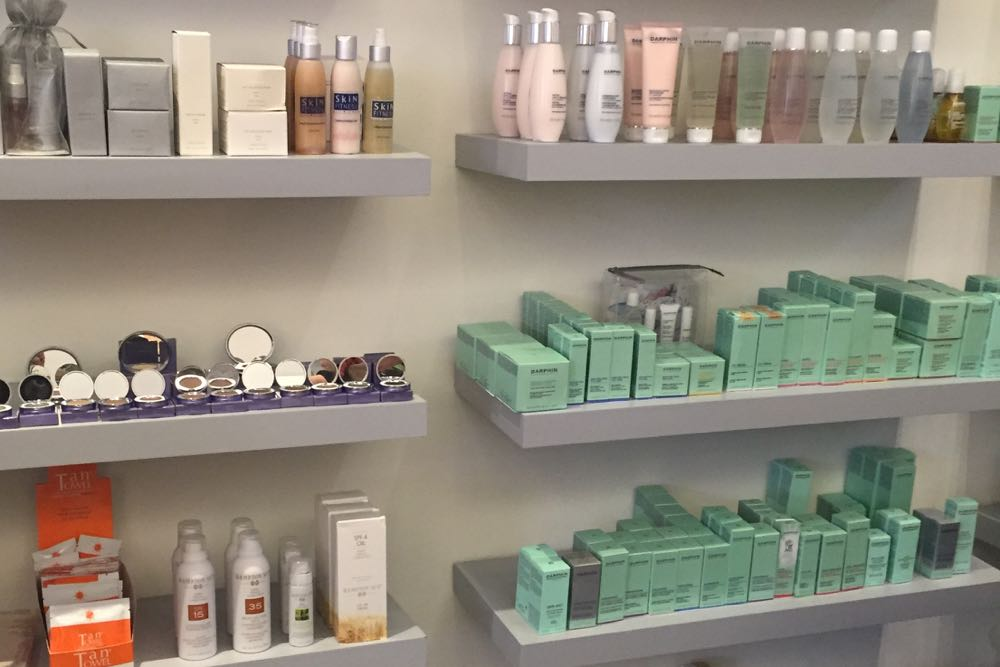 An array of skin care products lines the shelves at FG Beauty Boutique.