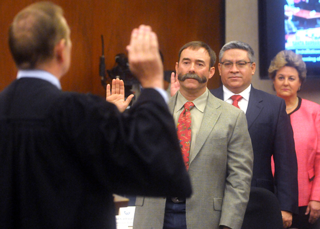 Superior Court Judge Thomas Adams gives the oath of office Tuesday to newly elected Santa Barbara County Fourth District Supervisor Peter Adam, center, and incumbent supervisors Salud Carbajal and Doreen Farr. (Lara Cooper / Noozhawk photo)