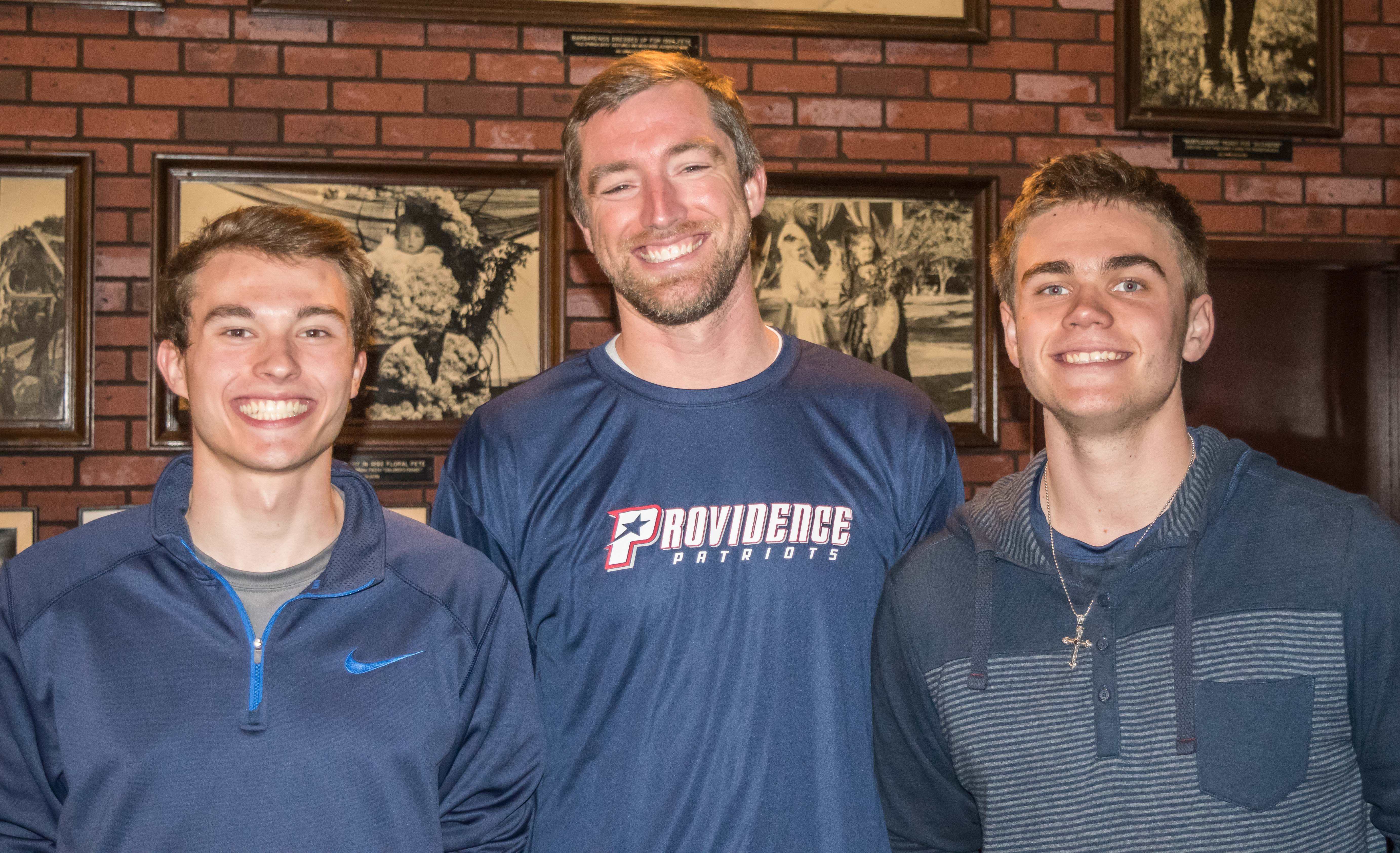Providence's Caleb Jones, coach Steve Stokes, and Ricky Beebe celebrated a strong season in which the Patriots reached the quarterfinals of CIF play